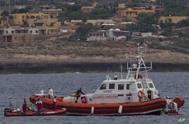 Italian Coast Guard personnel recover a body bag on their patrol boat in Lampedusa island, Oct. 8, 2013.