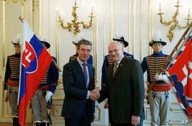 NATO Secretary General Anders Fogh Rasmussen, left, shakes hands with Slovakia's President Ivan Gasparovic, right, as they meet at the Presidential Palace in Bratislava, Slovakia,  May 15, 2014.