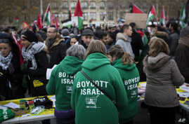 "Demonstrators wear shirts reading ""Boycott Israel"" during a protest against President Donald Trump's decision to recognize Jerusalem as Israel's capital at Republique Square in Paris, France, Saturday, Dec. 9, 2017."