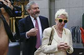 Jonathan Blackman, left, a lawyer representing Argentina, leaves federal court in New York on Tuesday, July 22, 2014.
