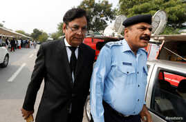 FILE - Saiful Mulook, left, the lawyer for  a Christian wo