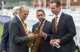 Former England cricketer John Stephenson, right, shows Britain's Prince Philip a bat that belonged to West Indian batsman Everton Weekes during his visit to Lord's Cricket Ground to open the new Warner Stand, in London, May 3, 2017.