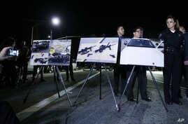 Police crime photos are displayed during a news conference near the site of yesterday's mass shooting in San Bernardino, Calif., Dec. 3, 2015.