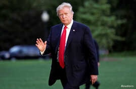 FILE - U.S. President Donald Trump waves as walks on the South Lawn of the White House upon his return to Washington, from the G-20 Summit in Hamburg, July 8, 2017.