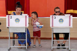 People vote in country's presidential elections at a polling station in Ulaanbaatar, Mongolia June 26, 2017.