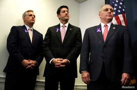 U.S. House Speaker Paul Ryan, center, stands between House Majority Leader Rep. Kevin McCarthy, left, and Majority Whip Rep. Steve Scalise during a news conference on Capitol Hill in Washington, May 11, 2016.