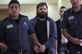 FILE - Israeli Yosef Haim Ben David, convicted in the killing of 16-year-old Palestinian Abu Khdeir, arrives at a court in Jerusalem, April 19, 2016. Ben David was sentenced Tuesday to life plus 20 years in prison.