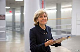 FILE - Sen. Kay Bailey Hutchison, R-Texas, walks to the floor of the Senate on Capitol Hill in Washington, Dec. 12, 2012, to give her farewell speech.