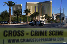 Crime scene tape surrounds the Mandalay Hotel (background) after a gunman killed at least 50 people and wounded more than 200 others when he opened fire on a country music concert in Las Vegas, Nevada, Oct. 2, 2017.