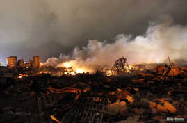 The remains of a fertilizer plant burn after an explosion at the plant in the town of West, near Waco, Texas early Apr. 18, 2013.