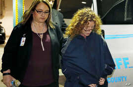 Tonya Couch, second from right, is escorted into Tarrant County Jail in Fort Worth, Texas, Jan. 7, 2016.