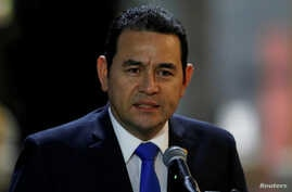 FILE - Guatemala's President Jimmy Morales speaks to the media after his arrival at Mariscal Sucre Airport in Quito, Ecuador, May 23, 2017, ahead of Ecuadorean president inauguration.