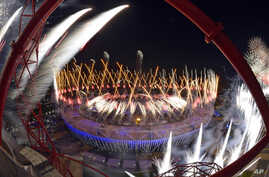Fireworks ignite over the Olympic Stadium during Opening Ceremonies of the 2012 Summer Olympics,  July 28, 2012, in London.
