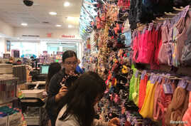 Young shoppers browse at a Claire's store in the Newport Mall in Jersey City, New Jersey, U.S.  Sept. 22, 2018.
