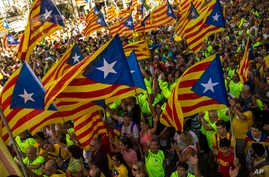 Catalans with estelada, or independence flags, gather during the Catalan National Day in Barcelona, Spain, Sept. 11, 2017.