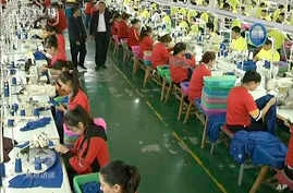 FILE - In this file image from undated video footage run by China's CCTV via AP Video, Muslim trainees work in a garment factory at the Hotan Vocational Education and Training Center in Hotan, Xinjiang, northwest China.