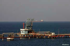 FILE - A view of pipelines and a loading berth of the Marsa al Hariga oil port in the city of Tobruk, east of Tripoli, Libya.