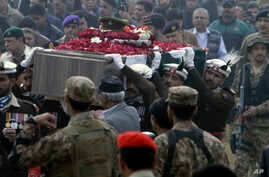 People attend the funeral of a Pakistani soldier in Lahore, Pakistan, Dec. 13, 2017.