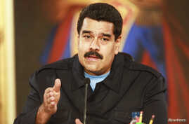 Venezuela's President Nicolas Maduro speaks during a meeting with mayors and governors at Miraflores Palace in Caracas, May 19, 2014.