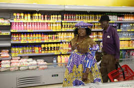 A Herero woman shops at a Shoprite store in Otjinene Village in the Omaheke Region, Namibia, Feb. 22, 2017.