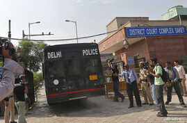 A police vehicle carrying four men accused of the gang rape of a 23-year-old woman on a bus on December 16, enters a court in New Delhi, September 10, 2013.