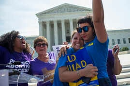 FILE - Bethany Van Kampen, left, hugs Alejandra Pablus as they celebrate during a rally at the Supreme Court in Washington, June 27, 2016, after the court struck down Texas' widely replicated regulation of abortion clinics.