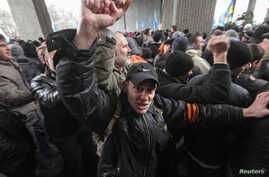 People attend a rally organized mainly by ethnic Russians near the Crimean parliament building in Simferopol Feb. 26, 2014.