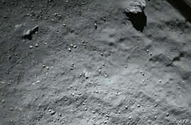 A handout photo released on November 13, 2014 by the European Space Agency, and taken by the Rosetta Lander Imaging System instrument, shows the surface of comet 67P/Churyumov-Gerasimenko during Philae's descent, from a distance of approximately 40 m