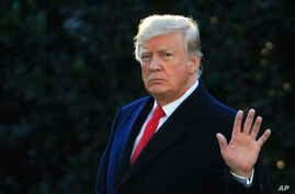President Donald Trump waves as he leaves the White House in Washington, Oct. 24, 2018, to attend a campaign rally in Mosinee, Wisconsin.