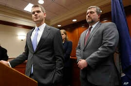 U.S. Attorney Thomas Cullen, left, speaks to the media along with FBI agent James Dwyer, right, after a plea agreement with James Alex Fields, who was charged with 30 counts stemming from a car attack in 2017, in Charlottesville, Va.,  March 27, 2019
