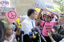Sen. Ted Cruz, R-Texas, center, talks to a Code Pink antiwar group member after the group interrupted his speech during a demonstration in Washington by the Concerned Women for America Legislative Action Committee to address the Obama administration'