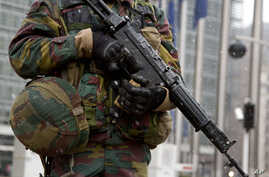 As a sign of increased security, a Belgian soldier patrols in front of European Union headquarters in Brussels, Jan. 19, 2015.
