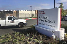 FILE - In this June 9, 2017, file photo, a vehicle drives into the Otay Mesa detention center in San Diego, Calif. The American Civil Liberties Union filed a class-action lawsuit  March 9, 2018, accusing the U.S. government of broadly separating immi