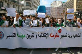 Algerian demonstrators march during a protest in Algiers, Apr. 2, 2019. Algerian protesters and political leaders are expressing concerns that ailing President Abdelaziz Bouteflika's departure will leave the country's secretive, distrusted power stru
