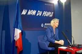 Marine Le Pen of the National Front party is seen as making the runoff in the French presidential election but failing to win. (L. Bryant/VOA)