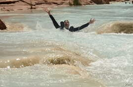 National parks traveler Mikah Meyer enjoys a bumpy float down the Colorado River during his visit to the Grand Canyon, in Arizona.