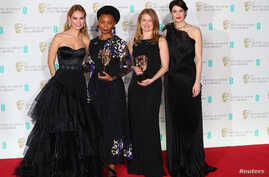 Rungano Nyoni and Emily Morgan hold their awards for an Outstanding Debut by A British Writer, Director or Producer for 'I Am Not A Witch' with citation readers Lily James and Gemma Arterton at the British Academy of Film and Television Awards (BAFTA