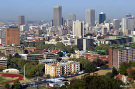 """FILE - Johannesburg is emerging as one of the continent's first """"mega-cities""""- bringing both opportunities and challenges as South Africa extends its dominance northwards."""