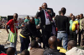 Mosiuoa Lekota, leader for Congress of the People (COPE) addresses mine workers at the Lonmin mine near Rustenburg, South Africa, Monday, Aug. 20, 2012.