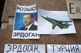 "Posters showing a portrait of Turkish President Recep Tayyip Erdogan and reading ""Wanted,""  ""Erdogan, Turkey,"" are left after a protest at the Turkish Embassy in Moscow, Nov. 25, 2015."