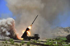 A view of a multiple rocket launcher during an exercise in this undated photo released by North Korea's Korean Central News Agency (KCNA) in Pyongyang July 15, 2014.