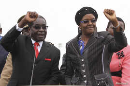FILE - Zimbabwean President Robert Mugabe and his wife Grace wave to supporters and guests during celebrations to mark his 90th birthday in Marondera about 80km (50 miles) east of the capital Harare, Feb. 23, 2014. Mugabe turned 90 on February 21.
