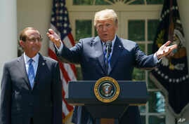 FILE - In this May 11, 2018 photo, President Donald Trump speaks during an event about prescription drug prices with Health and Human Services Secretary Alex Azar in the Rose Garden of the White House in Washington.