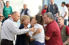 Relatives of Turkish soldiers react after a court decision in Silivri, September 21, 2012.