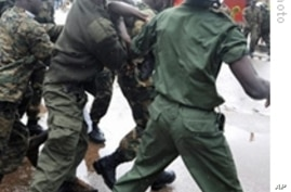 Guinean police arrest a protester on in front of the biggest stadium in the capital Conakry during a protest banned by Guinea's ruling junta, 28 Sep 2009