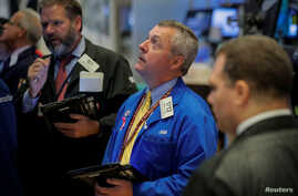 Traders work on the floor of the New York Stock Exchange in New York, Oct. 18, 2018.