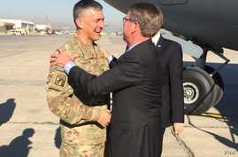 U.S. Defense Secretary Ash Carter arrives Dec. 11, 2016 in Baghdad, Iraq, to assess the progress of the fight against Islamic State in Mosul. He is greeted by Lieutenant General Stephen Townsend, commander of Operation Inherent Resolve. (Department o