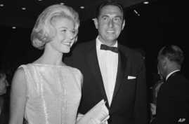 "FILE - In this April 4, 1960, photo, Doris Day, a best actress of the year nominee for her role in ""Pillow Talk,"" and her producer husband Marty Melcher, arrive for the annual Academy Award presentations at the Pantages Theater in Los Angeles."