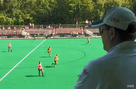 Coach Lee Bodimeade watches the U.S. woman's field hockey team in practice.