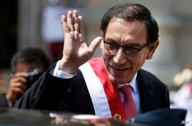 Peru's President Martin Vizcarra waves as he makes his way to the House of Pizarro, the presidential residence and workplace, in Lima, Peru, March 23, 2018. Vizcarra was sworn in, taking over from his predecessor, Pedro Pablo Kuczynski, who resigned